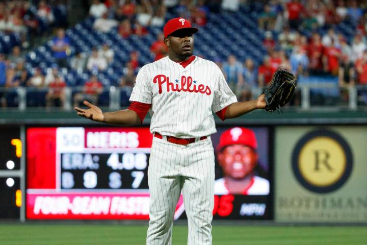 Philadelphia Phillies relief pitcher Hector Neris reacts after he was ejected for hitting Los A ...