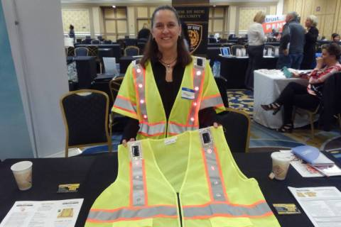 Megan Collins, co-founder of Solar LED Safety Products, is pictured with a safety vest she and ...