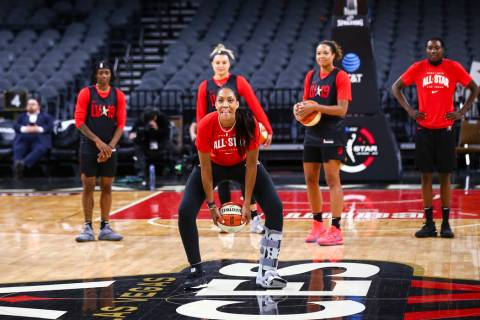 Las Vegas Aces' A'ja Wilson attempts a half-court shot during practice ahead of the WNBA All-St ...