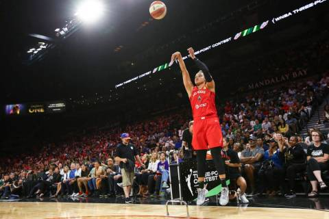 Las Vegas Aces' Kayla McBride competes in the 3-point shooting challenge during the WNBA All-St ...