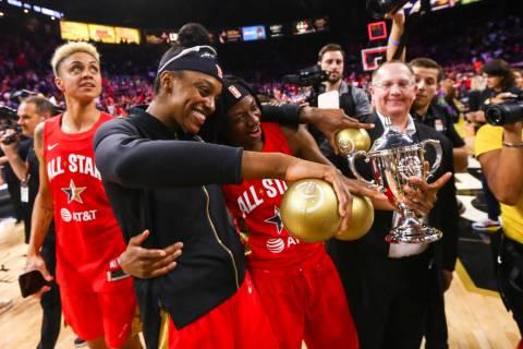 Chicago Sky's Diamond DeShields, center/left, celebrates with Indiana Fever's Erica Wheeler aft ...