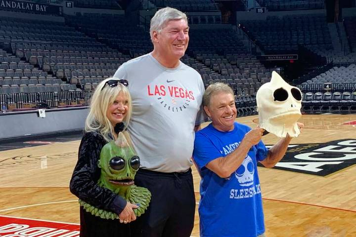 Bill Laimbeer, center, coach of the WNBA's Las Vegas Aces basketball team, poses for photos wit ...