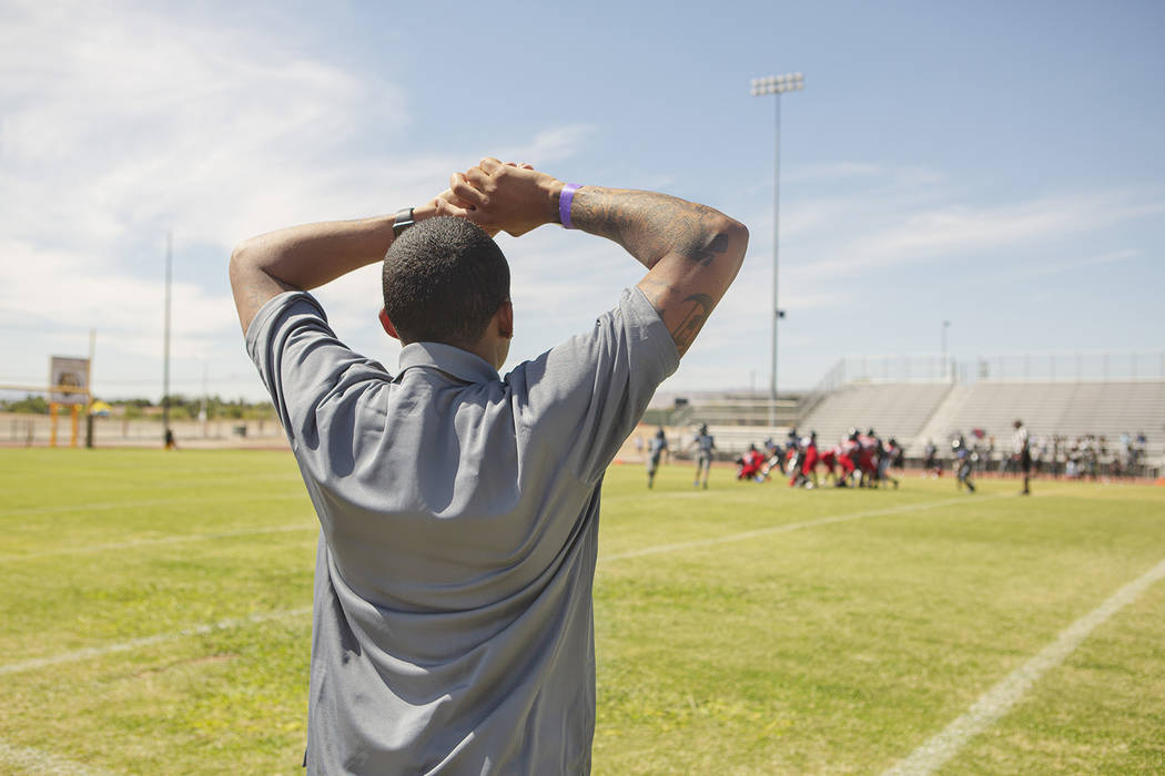 Devin Conway takes a breather as he anticipates a play during the TMT Red Lions game at Bonanza ...