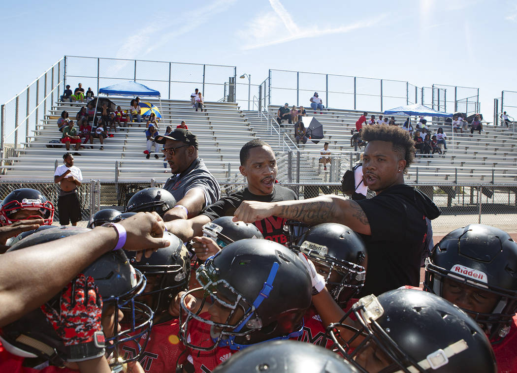 Devin Conway, center, huddles before the TMT Red Lions game at Bonanza High School on Saturday, ...