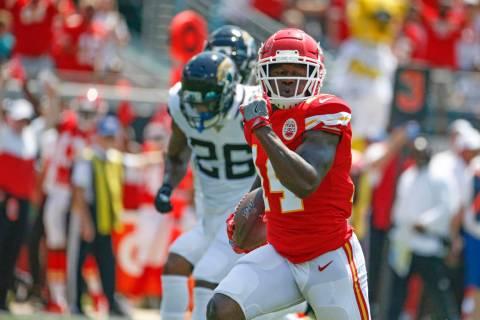 Kansas City Chiefs wide receiver Sammy Watkins, right, runs past Jacksonville Jaguars defensive ...