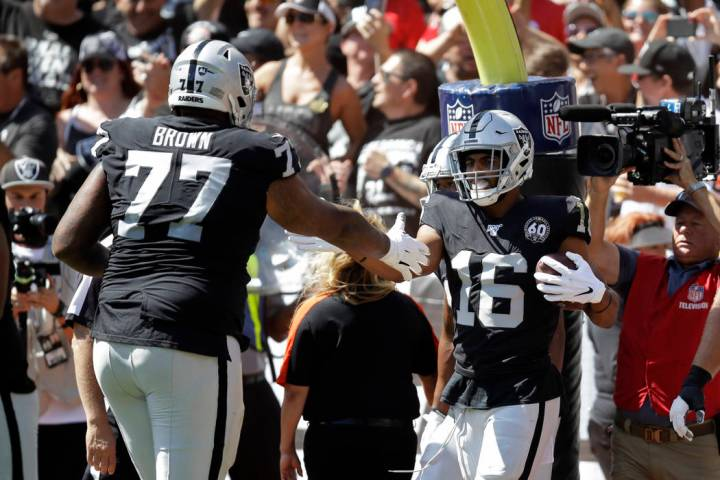 Oakland Raiders wide receiver Tyrell Williams (16) is greeted by offensive tackle Trent Brown ( ...