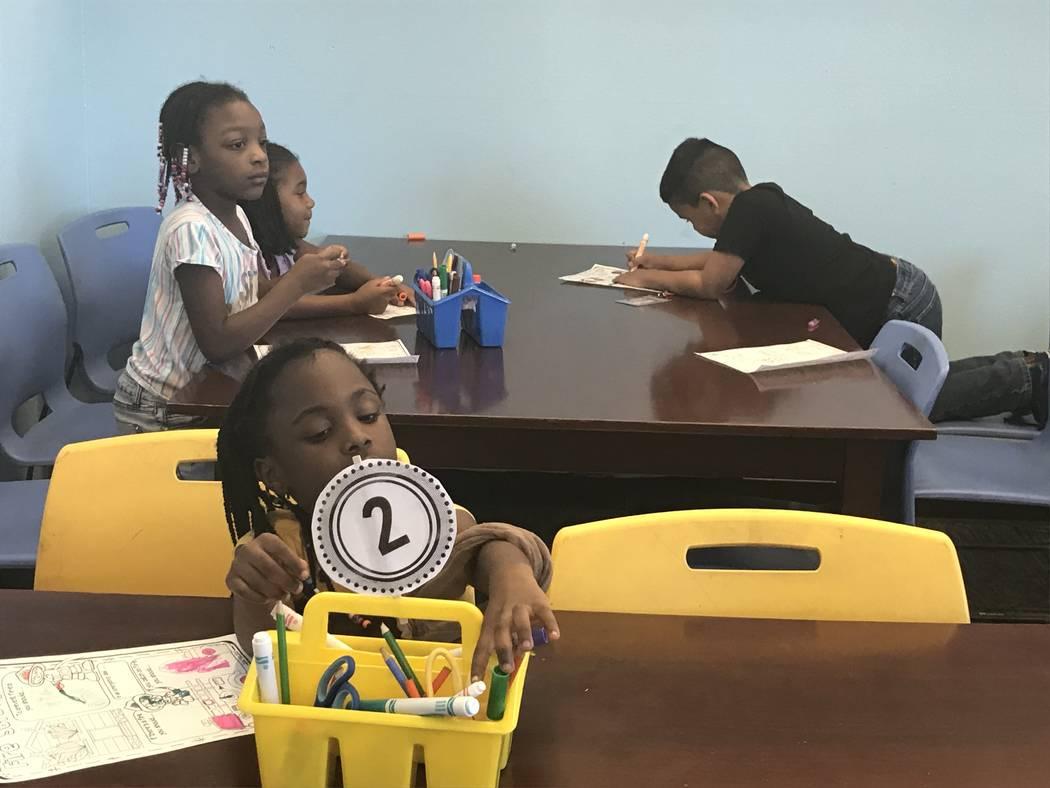 Julie Wootton-Greener/Las Vegas Review-Journal Children work on a fire safety worksheet Sept. 1 ...