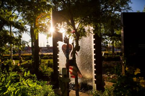 The sun highlights the water feature and other items at the Las Vegas Healing Garden in Las Veg ...
