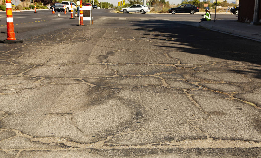 A damage road from trucks driving by in a no truck-zone lane is seen on Wednesday, Sept. 18, 20 ...