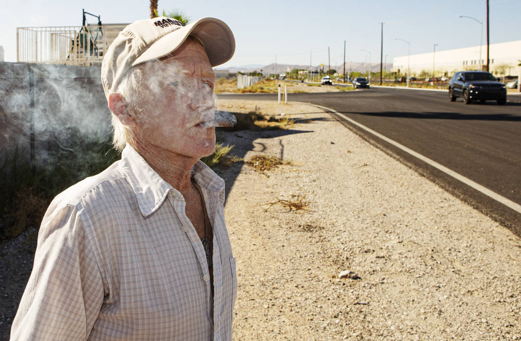 Jim Ludwick, 70, watches as trucks drive by his neighborhood on Wednesday, Sept. 18, 2019, in L ...