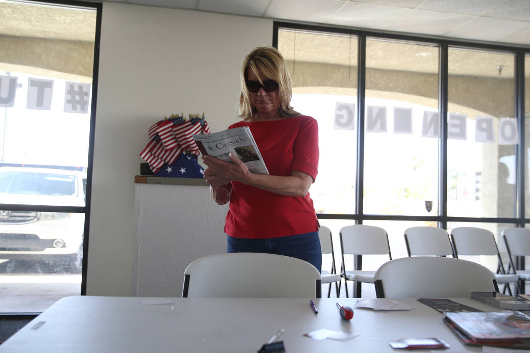Linda Cannon, vice chair of the Clark County Republican Party, organizes pamphlets after a brea ...