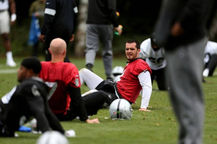 Oakland Raiders quarterback Derek Carr attends a training session during the media day at The G ...