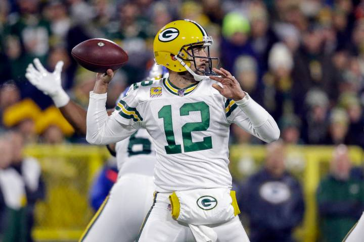 Green Bay Packers quarterback Aaron Rodgers drops back to pass during the first half of an NFL ...