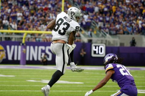 Oakland Raiders tight end Darren Waller (83) catches a pass over Minnesota Vikings cornerback T ...