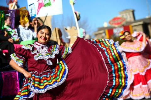 A member of Ballet Folklorico Flor de Castilla, of Reno, participates in the annual Nevada Day ...