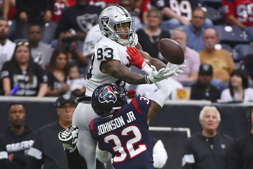 Houston Texans cornerback Lonnie Johnson (32) breaks up a pass intended for Oakland Raiders tig ...