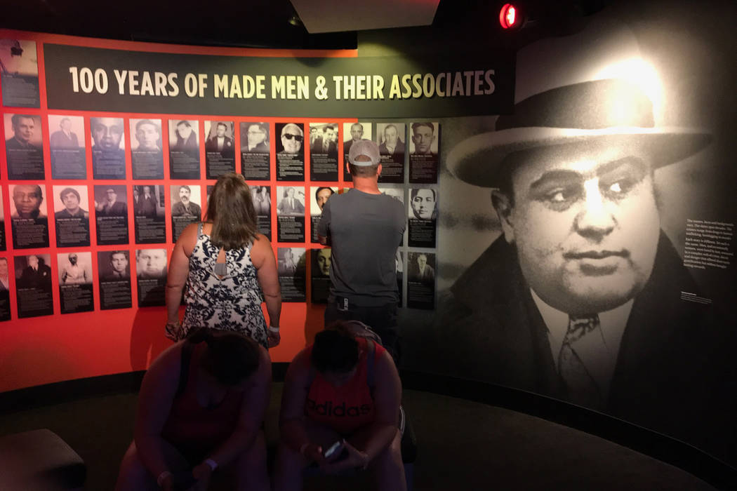 A wall of crime figures features Al Capone and others of his era. (Herb Jaffe)