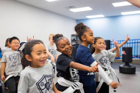 Second graders participate in their martial arts class at Pinecrest Academy, Nevada's newest ca ...