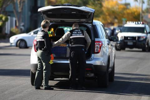 Las Vegas police investigate the scene of a shooting that left a boy dead at the intersection o ...