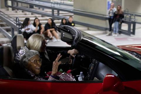 Audrey James, 105, rides through the UNLV homecoming parade as honorary homecoming queen on Fri ...
