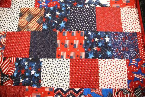 A quilts on display during a meet by members of Quilters for Veterans at the Sun City Anthem Ce ...