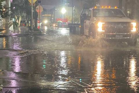 A truck runs through standing water on Linq Lane and Flamingo Road near the Las Vegas Strip, We ...