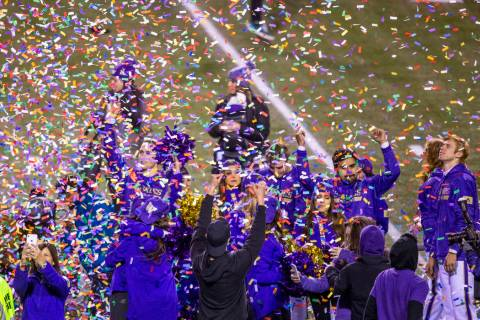 Confetti rains down on Washington Huskies cheerleaders while the trophy is presented after defe ...