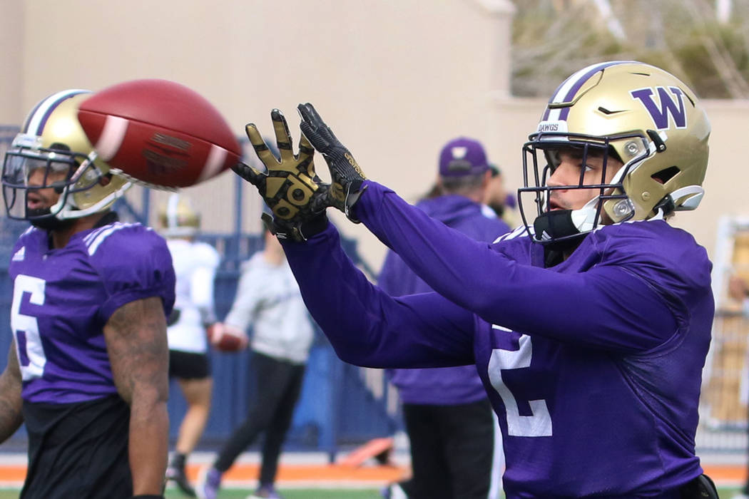 Washington Huskies wide receiver Aaron Fuller catches the ball during his team practice at Bish ...