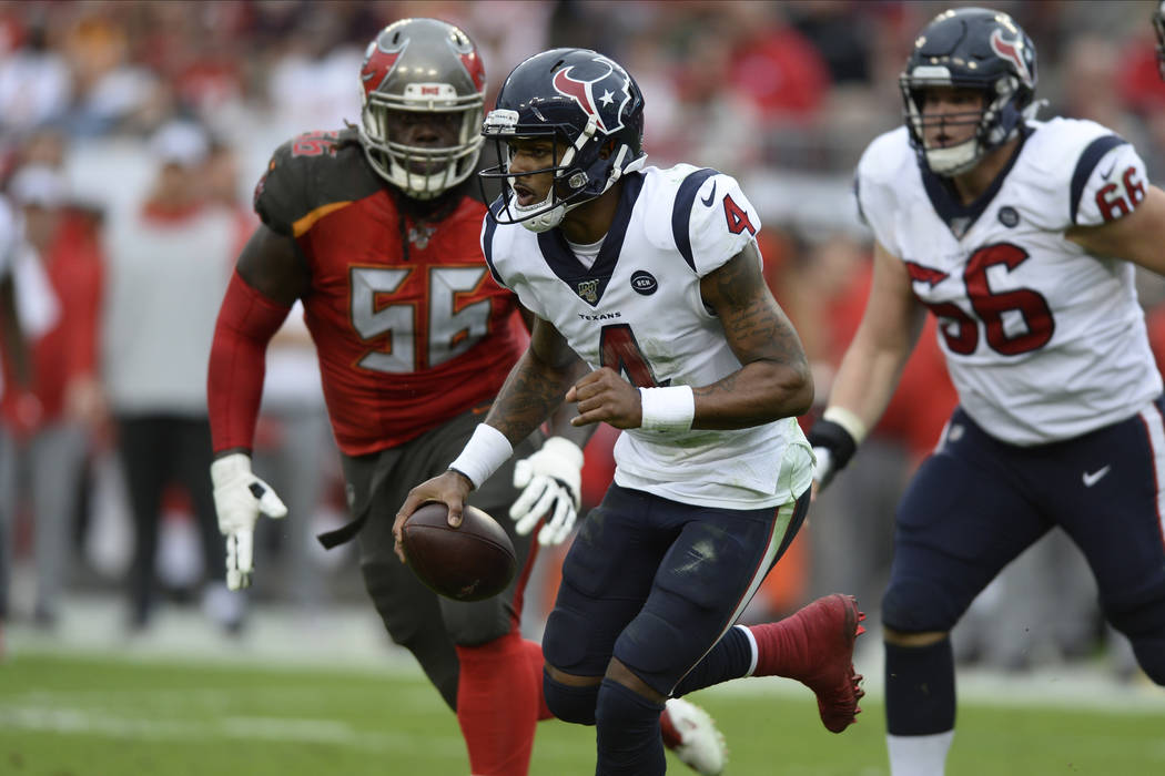 Houston Texans quarterback Deshaun Watson (4) outruns Tampa Bay Buccaneers defensive tackle Rak ...