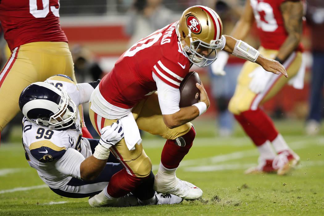 Los Angeles Rams defensive tackle Aaron Donald (99) sacks San Francisco 49ers quarterback Jimmy ...