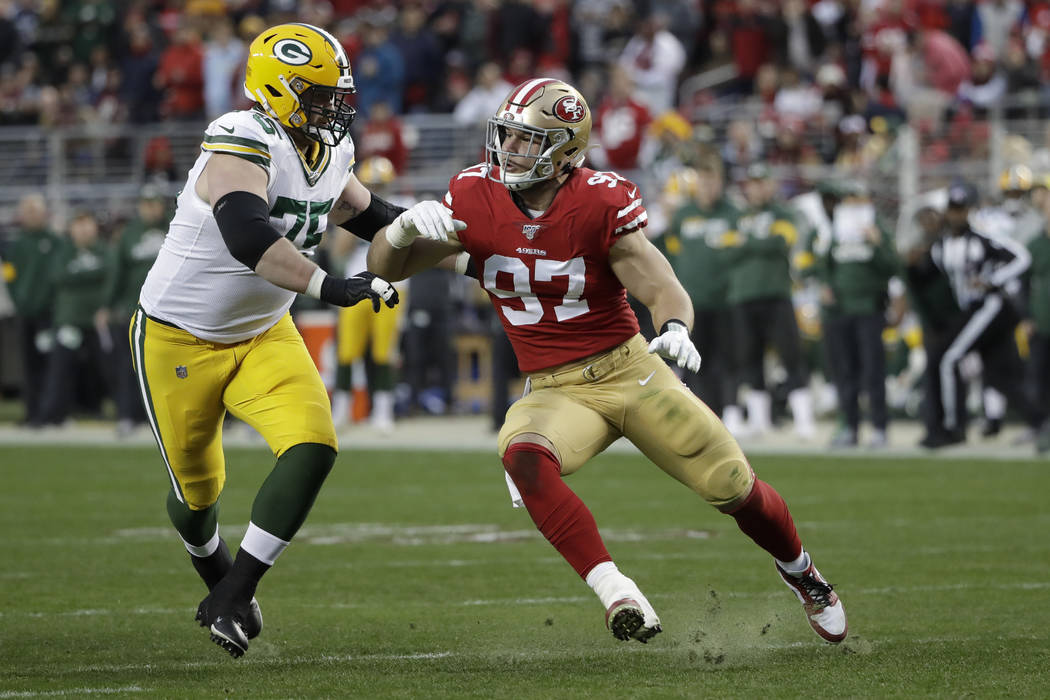 San Francisco 49ers defensive end Nick Bosa plays against Green Bay Packers offensive tackle Br ...