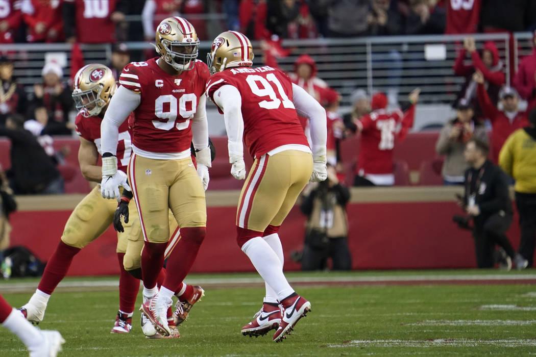 San Francisco 49ers defensive tackle DeForest Buckner (99) celebrates a play with defensive end ...