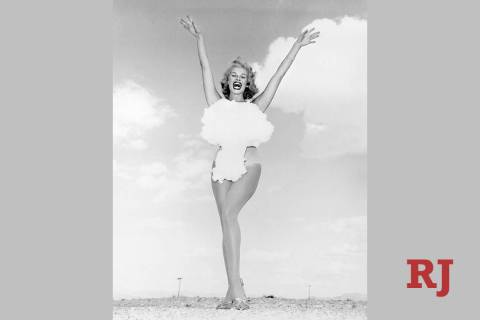 Lee Merlin, the last woman crowned Miss Atomic Bomb on May 24, 1957, sports a mushroom cloud ba ...