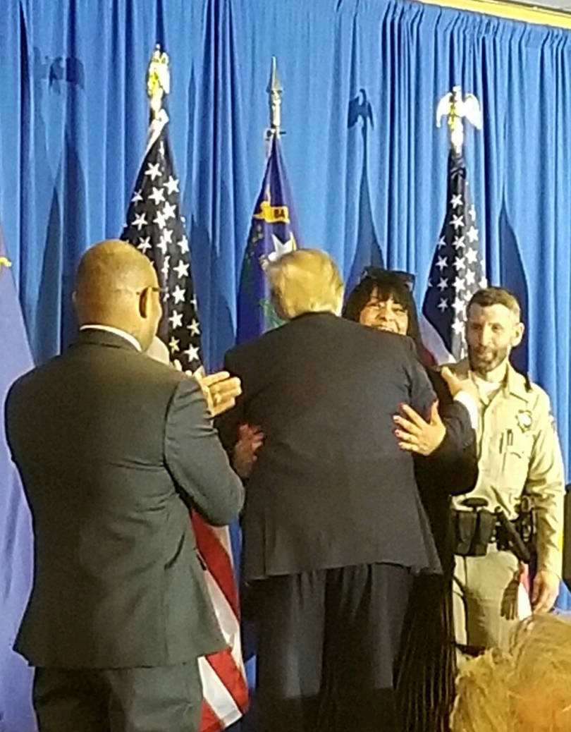 President Donald Trump embraces Lois Hockersmith on Feb. 20; surrounding them are Metro Police ...