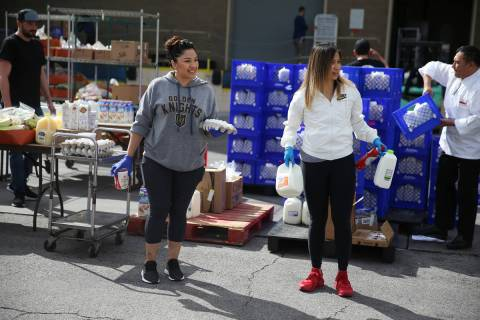 Assistant manager Jenny Leiva, left, and food and beverage manager Rovie Delapaz, wait to hand ...