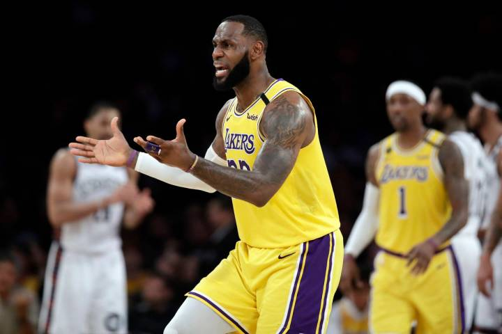 Los Angeles Lakers' LeBron James argues a call during the second half of an NBA basketball game ...