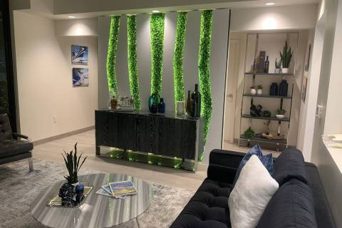 Studio G Architecture designed a wall for Thrive Aviation's hangar lounge. The setting is per ...