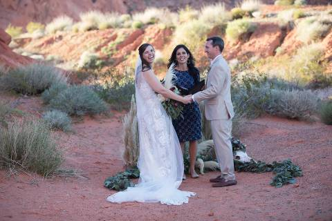 Amanda Monk presides over the wedding ceremony of Ashley Johns and Will Hinder at Valley of Fir ...
