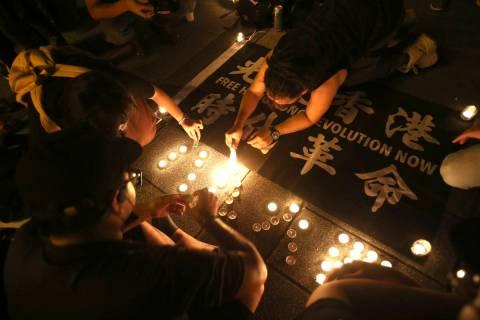 Hong Kong participants attend a candlelight vigil at Democracy Square in Taipei, Taiwan, Thursd ...