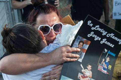 Jeannie Llera, right, mother of Jorge Gomez, who was fatally shot last week by Las Vegas police ...