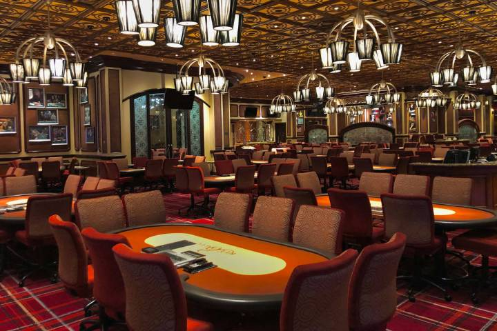 The poker room sits vacant within the Bellagio as MGM shuts down casino operations at midnight ...