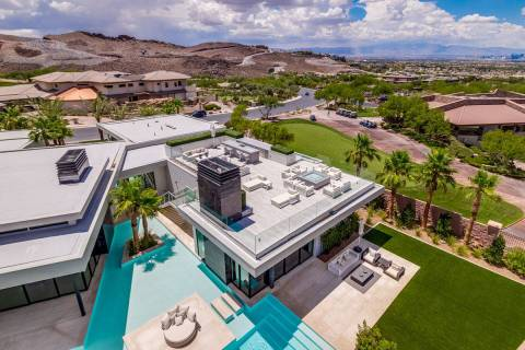 This custom home in MacDonald Highlands has water features, which is a trademark of Dan Coletti ...