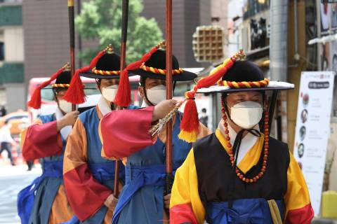 South Korean Imperial guards wearing face masks to help protect against the spread of the new c ...