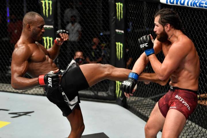 (L-R) Kamaru Usman of Nigeria kicks Jorge Masvidal in their UFC welterweight championship fight ...