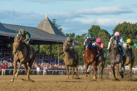 Code of Honor, left, with jockey John Velazquez, leads the field to the finish line to win the ...