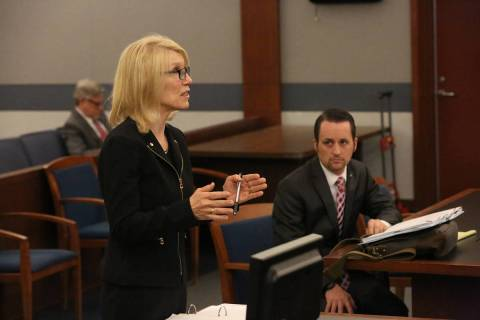 Samuel Warren, right, listens as Alice Denton, attorney for Larry Bertsch, requests that Distri ...