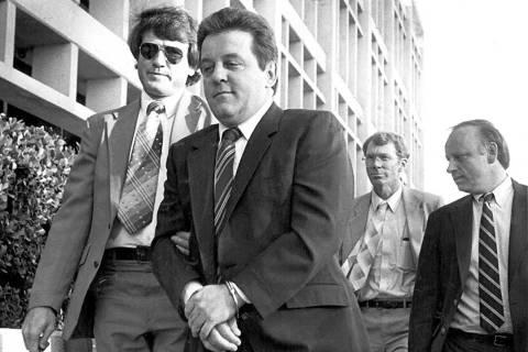 Reputed mobster Anthony Spilotro is taken into custody in Las Vegas in 1983. (Scott Henry/Las V ...