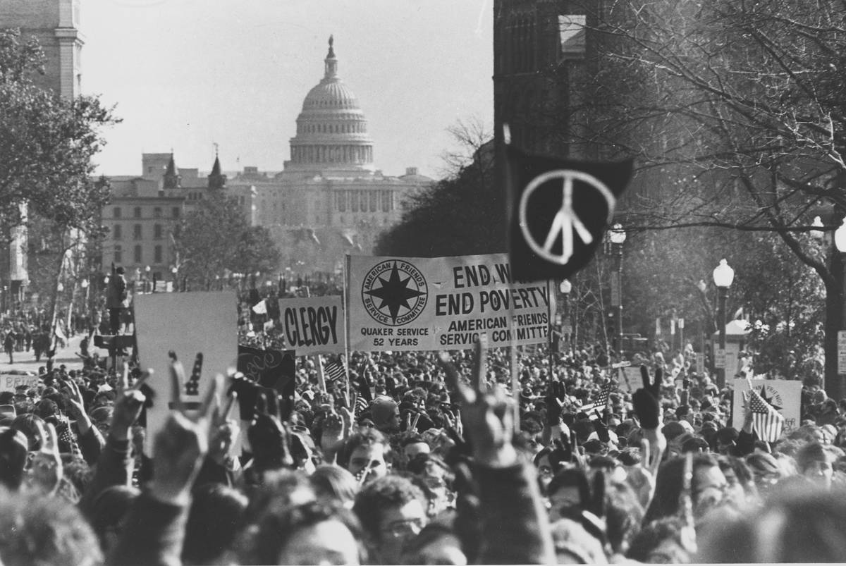 With the U.S. Capitol in the background, demonstrators march along Pennsylvania Avenue in an an ...