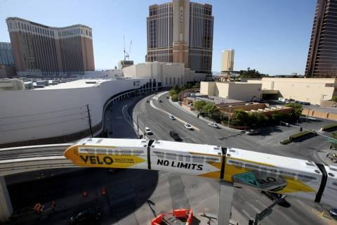 Las Vegas Monorail trains pass the under-construction MSG Sphere performance venue in Las Vegas ...