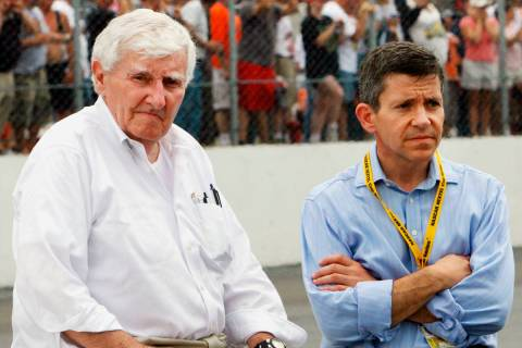 Owners of New Hampshire International speedway Bob Bahre, left, and son Gary Bahre wait out a r ...